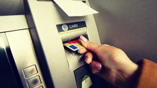 Switzerland begins move to common ATM standard