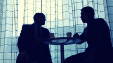 two business men silhouette sitting 3