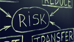 Risk on chalkboard