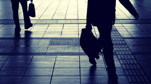 silhouette business man walking with suitcase