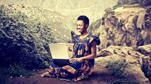 African lady on laptop