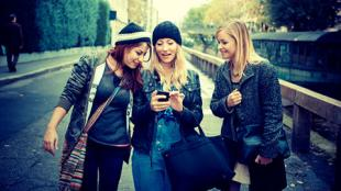 Hipster teens with phone