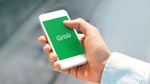 Ride-hailing app Grab partners Maybank for mobile wallet launch